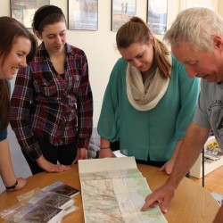 MATC Guidebook Editor Ray Ronan look at A.T. maps with Teens To Trails Outreach Coordinator Meghan Henshall and Brunswick High School Outing Club Members Marina MacKinnon and Phoebe Keyes