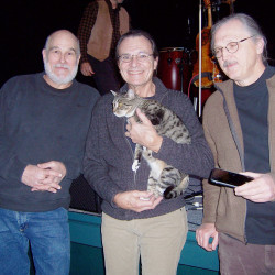 Minutes before returning to the stage for a performance at the Rockland Strand, members of Beasoleil avec Michael Doucet take a moment to do their part to raise awareness of pet adoption by getting photos taken with Noel, an adoptable cat from P.A.W.S.