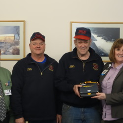 From L to R: Cal Wilson, Director of Mayo Materials Management, Milo Fire & Rescue Assistant Fire Chief Kevin Black, Milo Fire & Rescue Fire Chief Dave Preble, and Mayo Regional Hospital President & CEO Marie Vienneau.