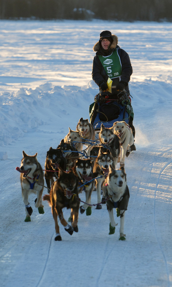 Martin Massicotte of Ste-Tite, Quebec, crosses Portage Lake during the 2015 250-mile Can-Am Crown International dog sled race at the first check point at Portage Lake Saturday.