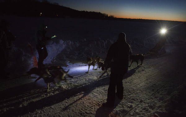Ashley Patterson of Shirley, Maine crosses the time line during the 2015 250-mile Can-Am Crown International dog sled race at the first check point at Portage Lake Saturday.