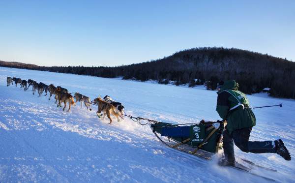 Andrew Longchamps of Pont-rounge, Quebec, makes his way across Portage Lake during the 2015 250-mile Can-Am Crown International dog sled race to the first check point at Portage Lake Saturday.