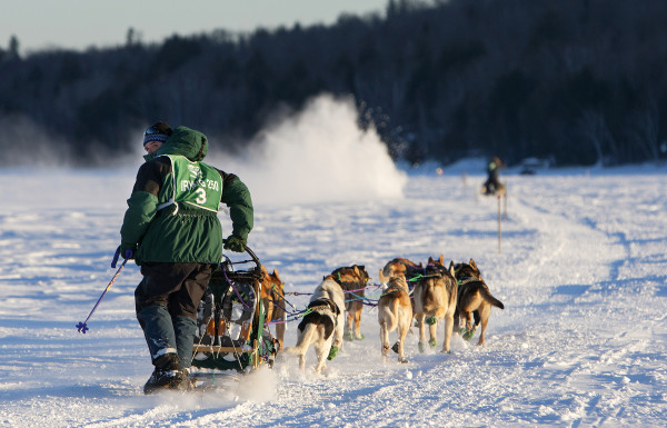 Andrew Longchamps of Pont-rounge, Quebec, looks back while crossing Portage Lake during the 2015 250-mile Can-Am Crown International dog sled race to the first check point at Portage Lake Saturday.