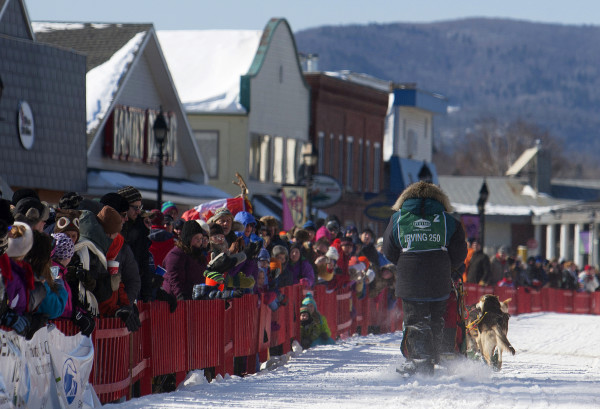 Ashley Patterson slide down Maine Street in Fort Kent Saturday for the start of the 250-mile Can-Am Crown International dog sled race.