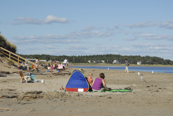 People relax at Popham Beach in Phippsburg in this 2012 file photo. This section of the beach lies within Popham Beach State Park.