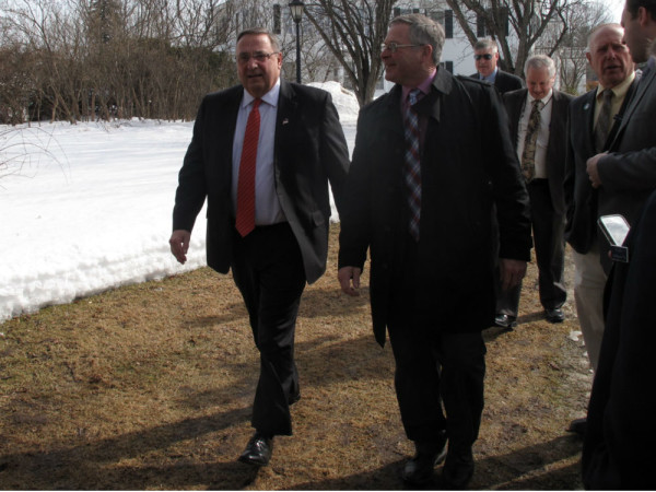 Gov. Paul LePage, left, walks Tuesday at the Blaine House with Walter Whitcomb, his commissioner for Agriculture, Conservation and Forestry.