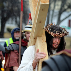 Prayerful procession of Catholics participate in live depiction of Christ's final hours in Bangor, Brewer