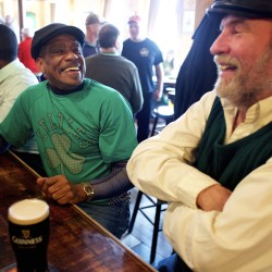 From left, friends James Williams and Mark Kaufmann drink a pint of Guinness together and remember old times while celebrating St. Patricks Day at Paddy Murphy's Tuesday morning in Bangor. Kaufmann performed Irish music at 6 a.m. at Paddy Murphy's that morning.