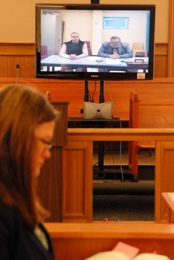 With Assistant Attorney General Deborah Cashman looking on, murder suspect Reginald Dobbins appears at Houlton District Court on Monday, March 9, 2015.