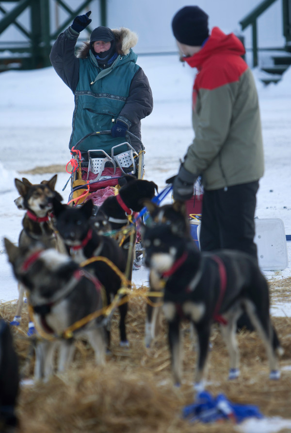 Ashley Patterson signals she's ready to go at the second check point of the 250-mile Can-Am Crown International dog sled race at Rocky Brook on Sunday.