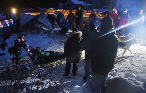 Andre Longchamps comes into the Allagash check point during the 2015 250-mile Can-Am Crown International dog sled race Sunday.
