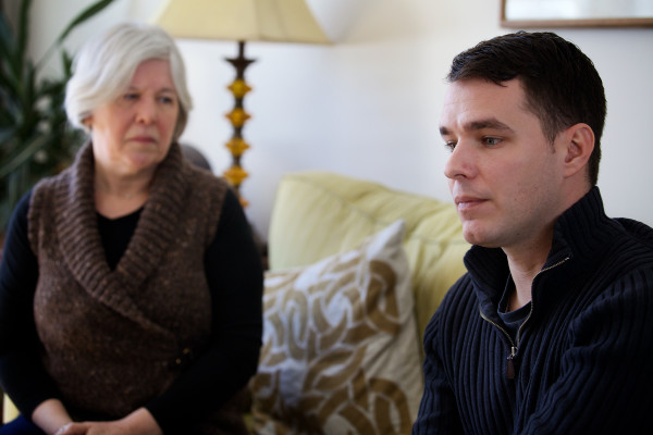 Brenda Norris listens as Andrew Bossie talks about his younger brother Ryan, 26, in Portland on Tuesday and the family's decision to reveal he died of addiction in his obituary a little over a month ago.