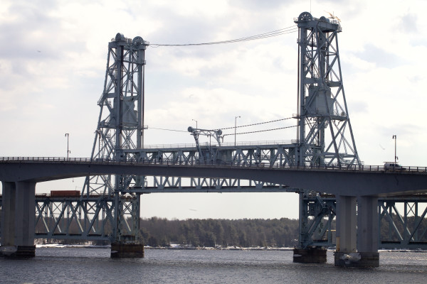 The Carlton Bridge is seen behind the Sagadahoc Bridge from the Bath waterfront on March 11. The span, built in 1927 to carry railroad and motor cars over the Kennebec River, has only carried trains since the Sagadahoc Bridge was opened in 2000.