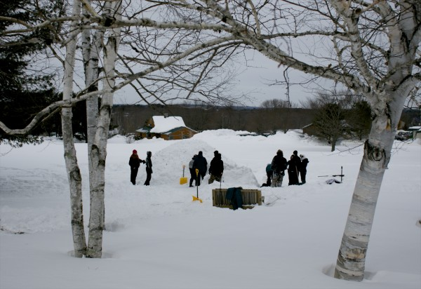 Unity College students build a quinzhee, a type of snow shelter, as part of a winter ecology class Thursday.