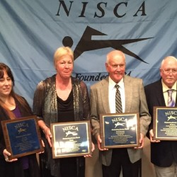 Brewer High School swimming coach Kathy Cahill (left) received the National Interscholastic Swim Coaches' Association Outstanding Service Award Saturday evening at the association's national meeting held at Greensboro, North Carolina. Also receiving the award were Liz Hill (second left) of Anne Arbor, Michigan, Dick Marcussen of Cedar Falls, Iowa and Jeff Johnson of Acton, Massachusetts.