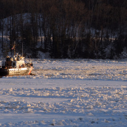 Coast Guard ice cutters tear through Penobscot River as crowd gathers