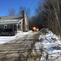 Fire destroys garage, damages house