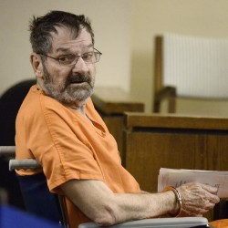 Accused Kansas killer with 'murder' tattoo to wear turtleneck at trial