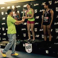 Lake Region High School's Kate Hall is congratulated on the podium after winning the national title in the long jump on March 14 at the New Balance Nationals track and field championships at The Armory in New York City.