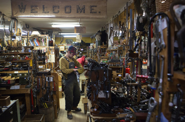 Travis Sehorn looks through a box of tools at Liberty Tools in Liberty Saturday. Last year Skip Brack created waves that reverberated beyond Maine's borders -- among people who love tools -- when he put Liberty Tool up for sale. No buyer has been found yet.