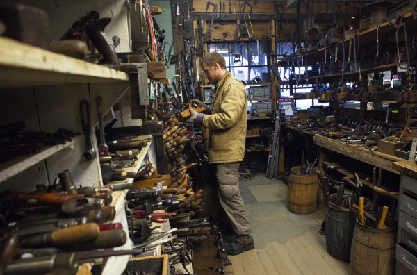 Ryan Brubaker looks over various woodworking tools at Liberty Tools in Liberty Saturday. Last year Skip Brack created waves that reverberated beyond Maine's borders -- among people who love tools -- when he put Liberty Tool up for sale. No buyer has been found yet.