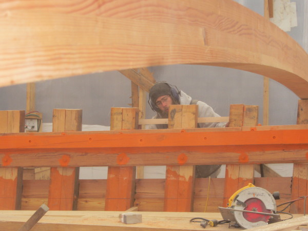 Restoration of the schooner Nathaniel Bowditch continues as James Kimmet works on the vessel.