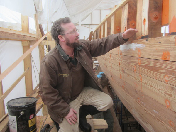 Capt. Noah Barnes shows off some of the work done on the restoration of the schooner Nathaniel Bowditch.