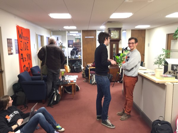 Nearly two dozen members of Bowdoin Climate Action sat outside Bowdoin College President Barry Mills' office Wednesday morning, refusing to leave until the college agreed to work with the students to divest the Bowdoin's endowment from fossil fuels.