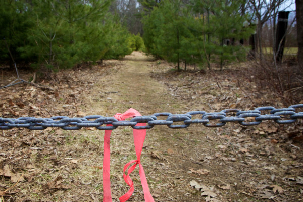 A chain guards the entrance to the Knight's Pond and Blueberry Hill parcel in Cumberland where local land trusts hope to conserve a 215 acre parcel. Supporters held a press conference on Monday urging Gov. Paul LePage to release approved bond funds to seal the deal.