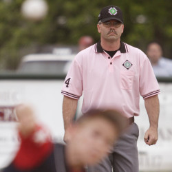 Bangor District 3 umpire Troy Lare monitors the action from second base during a Little League all-star game in Bangor on June 30, 2011.