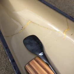 The canoe of Hermon paddler Mark Risinger was broken in two and badley damaged during a 2014 training run on Souadabscook Stream. On Saturday, Risinger used the repaired canoe to participate in the 36th St. George River Race in Searsmont.