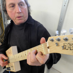 Pews unscathed in fire find new life in Bath luthier's custom guitar to benefit church
