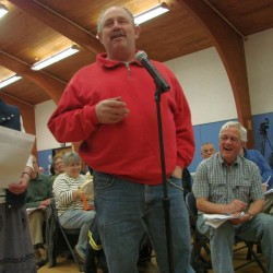 North Yarmouth Public Works Director Clark Baston answers a question during the April 11 annual Town Meeting. Behind him is Marnie Diffin, the town's former administrative assistant and interim town manager.