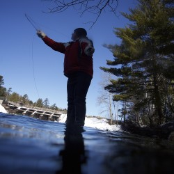 Scott Dionne of Mars Hill casts at Grand Lake Stream on the frigid first day of traditional open water fishing in Maine on Wednesday.