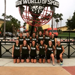 The Old Town High School softball team poses in front of ESPN Wide World of Sports Complex logo in Orlando, Florida. Coach Jenn Plourde's Coyotes returned to Maine with a 4-3 record.