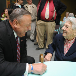 Clara Swan shares a laugh with Gov. Paul LePage during an early celebration of Swan's 103rd birthday at Husson University on Tuesday.  LePage, who graduated in 1971, studied at Husson when Swan was a staff member.