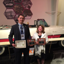 OHTM Auction and Event Coordinator Toby Stinson (left) and OHTM Volunteer Coordinator Niki Janczura show off three NAAMY awards presented to the Museum at the National Association of Automobile Museums annual conference at the National Packard Museum in Warren, OH.