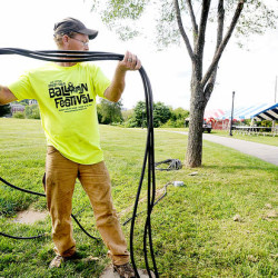 Stacey Pingree of Poland runs electricity underground in August 2014 at Simard-Payne Memorial Park while getting the grounds ready for the Great Falls Balloon Festival. Pingree works for Harold Brooks Construction. The power cords were stored in a trailer that was burglarized. Festival organizers estimate $40,000 to $50,000 worth of copper power cords were stolen.