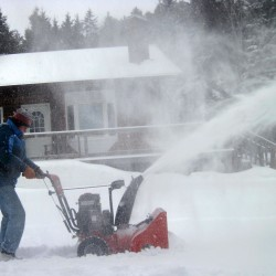 Snow falls across Maine as temperatures rise slightly