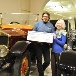 OHTM Executive Director Russ Rocknak accepts a check for more than $125,000 from Dawn Swinton. Swinton's late uncle, Thomas Appleton Plaisted, left the funds in trust for OHTM. Russ and Mrs. Swinton elected to execute the check passing in front of the Museum's 1913 Rolls-Royce Silver Ghost which originally belonged to Plaisted's ancestor, Alice Longfellow.