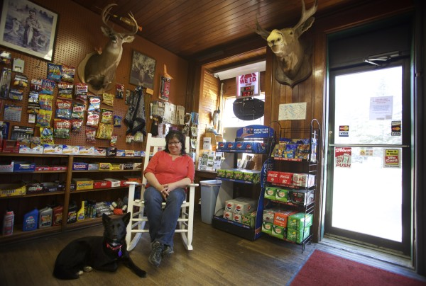 Brinda Leighton sits with Ava at the Pine Tree Store in Grand Lake Stream which she now operates along with Leslie Severance at the popular fishing destination in Maine.