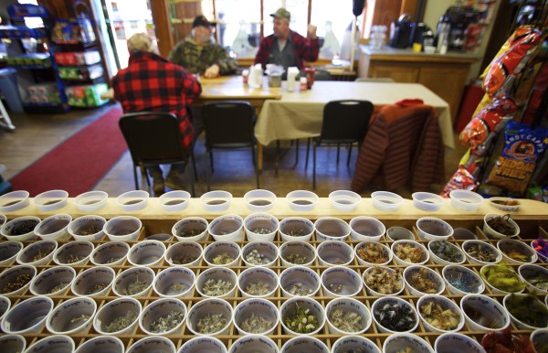 Dozens of different flies are for sale in the center of the Pine Tree Store in Grand Lake Stream which is now under new ownership at the popular fishing destination in Maine.