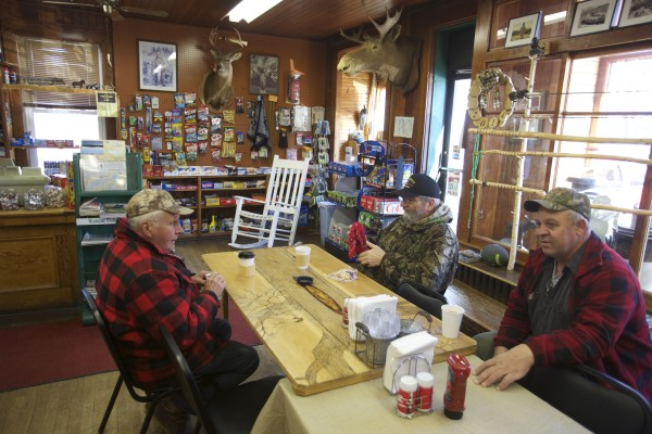 From left, Galan Williamson, Richard Denis and Gary Santerre drink coffee at the Pine Tree Store in Grand Lake Stream that is now under new ownership at the popular fishing destination in Maine.