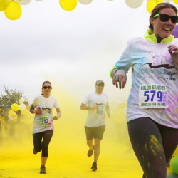 Participates get covered with color during the Color Bangor May 17 run to benefit the American Folk Festival Sunday in Bangor. Participates were covered in color at different color zones during the fun run.