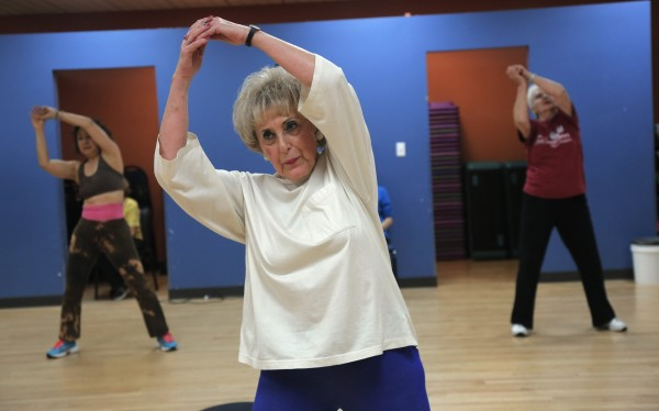 Louise Yoss exercises in the Silver Sneakers Zumba class at the Aaron Family JCC in Dallas, Dec. 12, 2013.