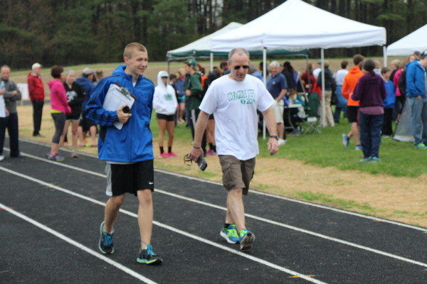 Connor Archer (left) walks the track with Old Town High School teacher Steve Dexter, his mentor, who was his cross country coach in middle school. They were on hand at the Victory Field complex on the Old Town High School campus on May 18, 2014 for a fundraising event Archer organized, Courageous Steps.