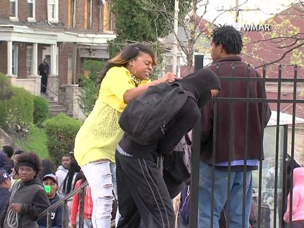 A woman striking a hooded youth, identified by local media as Toya Graham and her 16 year old son Michael, is seen in a still image from video taken on April 27, 2015 and provided by abc2news.com, in Baltimore, Maryland.