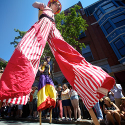 Stilt walkers from the Shoestring Theatre make their way down Lower Exchange Street in Portland Sunday June 10, 2012 during a parade at the 39th annual Old Port Festival.