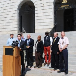 """Portland City Councilor Justin Costa speaks at a May 7 press conference, where officials spoke out against racially motivated attacks and vandalism in the city. """"It is important to be emphatic ... these actions have no place in the city of Portland,"""" he said."""
