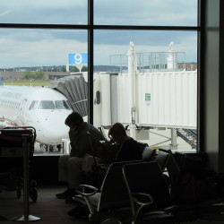 Passengers wait to board their flights at Portland International Jetport in this 2013 file photo.